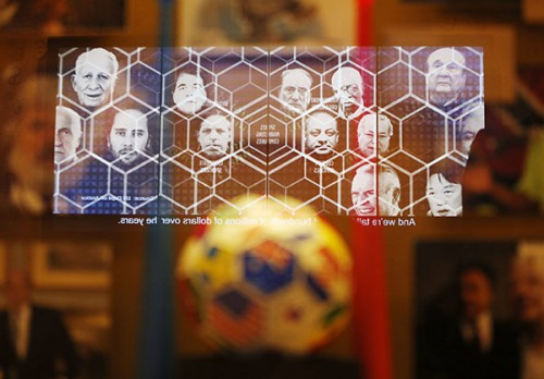 "A video on FIFA corruption is reflected in a display at the Mob Museum Tuesday, Sept. 1, 2015, in Las Vegas. The display, titled ""The 'Beautiful Game' Turns Ugly"", opens at the museum Tuesday. (AP Photo/John Locher)"