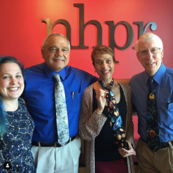 Four people in front of nhpr logo