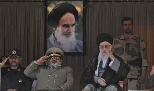 Supreme Leader Ayatollah Ali Khamenei, right, attends a graduation ceremony of army cadets, accompanied by Revolutionary Guard commander Mohammad Ali Jafari, left, Chief of the General Staff of Iran's Armed Forces, Hasan Firouzabadi, second left in Tehran, Iran, Saturday, Oct. 5 2013. (AP Photo/Office of the Iranian Supreme Leader)