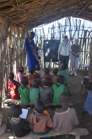 My mother and sister stand at the front of the classroom.