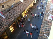 Looking down on the tourists walking the Ponte Vecchio from above.