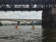 Zeke and Andi paddle under the railroad bridge.