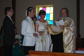 The Crowning is a Greek Tradition. The crowns are connected by a ribbon.