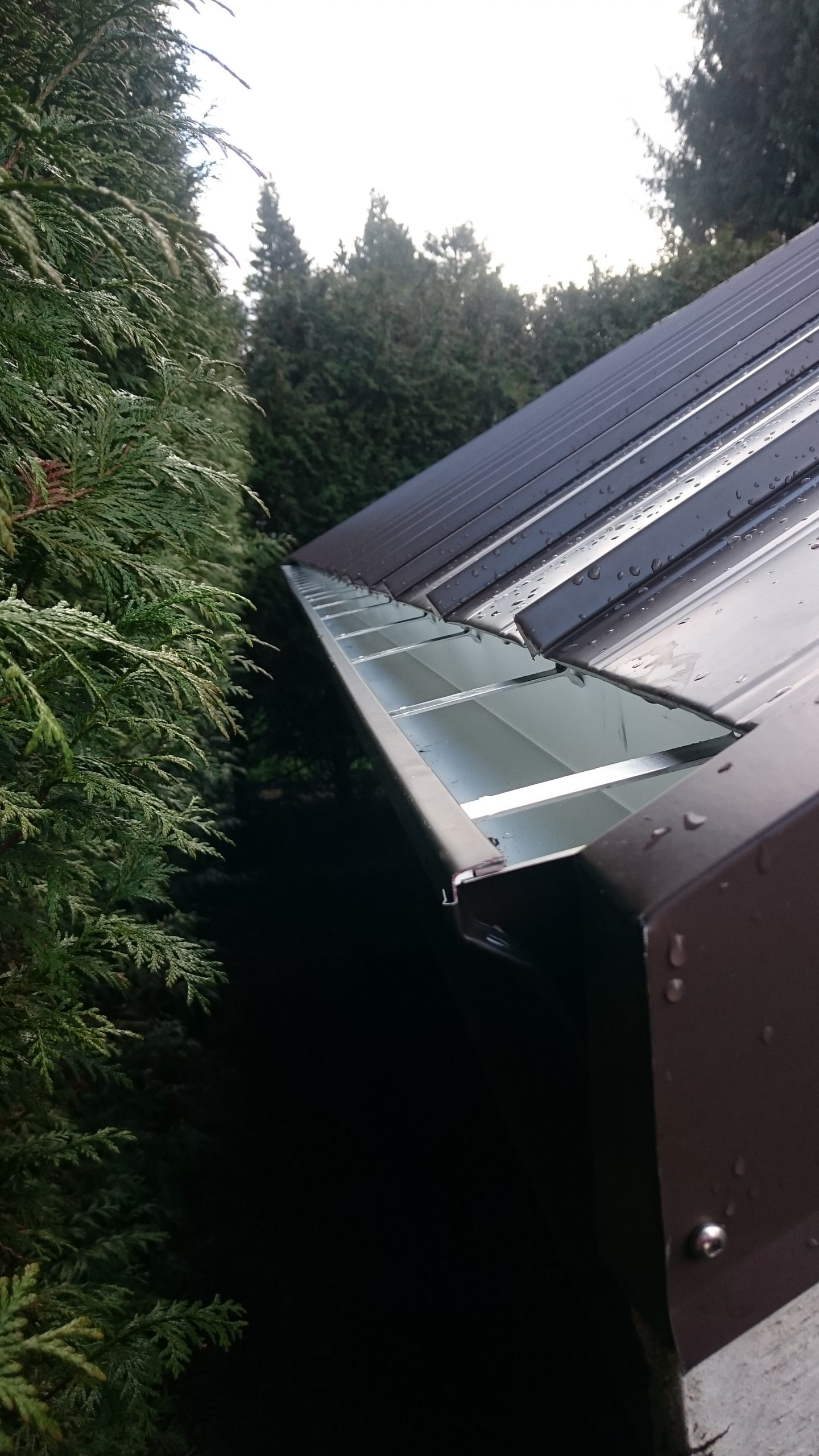 new seamless gutters and metal roof install