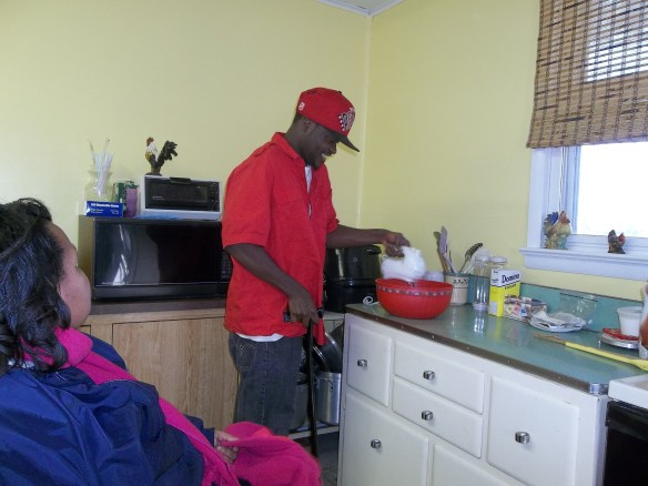 Amy's watching Durell make a cake for Maryann's birthday. Mix it up Durell, mix it up!