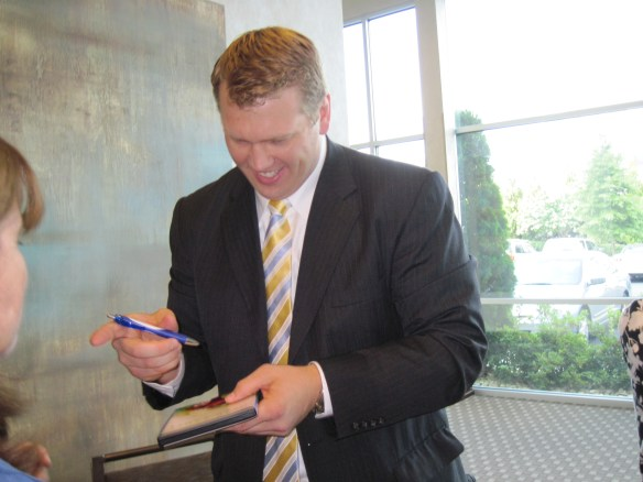 "Chris Nowinski, former WWE wrestler and co-founder and president of the Sports Legacy Institute, signing our copy of the ""Head Games"" documentary."