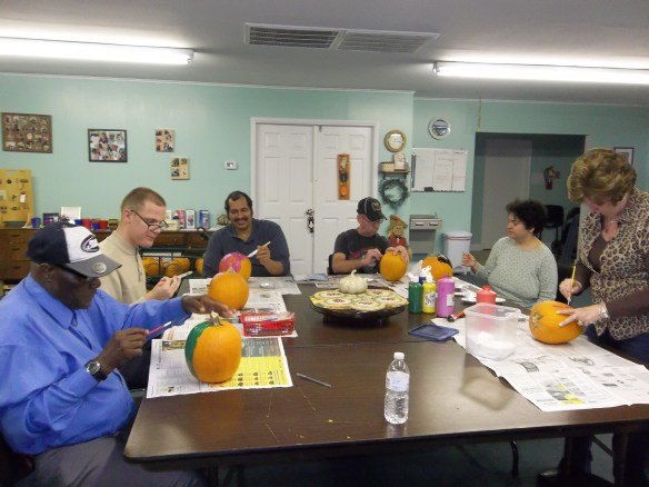 Mr. William says......Everyone having a good time painting the pumpkins together!!  Amy says.....boy, it was  a lot of fun!!