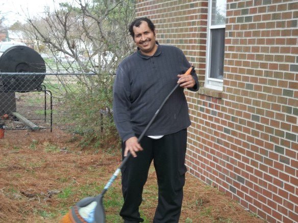 Zel having some fun cleaning up the yard to get ready for spring planting in our community garden!