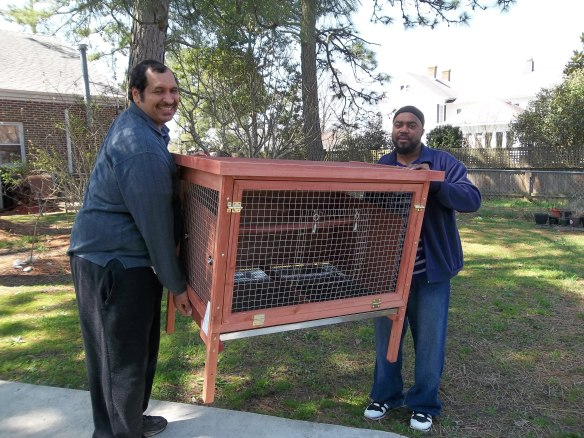 Zel and Steve carrying in our new chicken coop!  This is going to be one of our new adventures!!!  Stay tuned to see more of our work in progress!