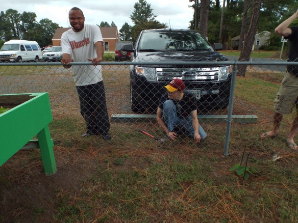 DJ and Brandon planting some tulips and flowers that will bloom next spring! John says