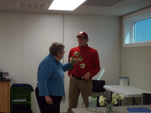 Our Board Member Rosemary brought pretty flowers in to show us. Brandon is our plant expert!