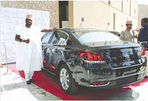 Kunle-Afolayan-with-his-new-Peugeot-508