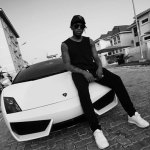 Runtown issues a memo to his haters as he shows off his 'Lamborghini Gallardo'