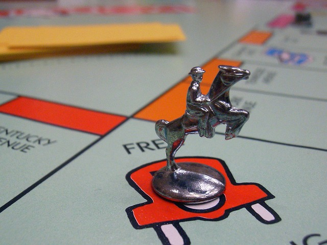 Monopoly board with horse and rider on Free Parking symbolizes Christian deception.