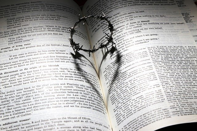 This is a picture of the Bible with a crown of thorns making a shadow of a heart symbolizing God's promises.