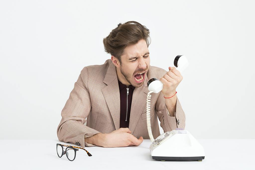 This is a man screaming in frustration into the phone.