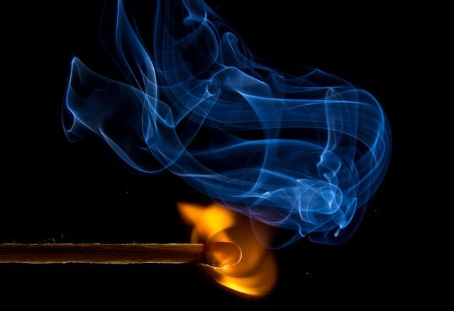 """This is a picture of a lit match with smoke rising to represent """"strange fire."""""""