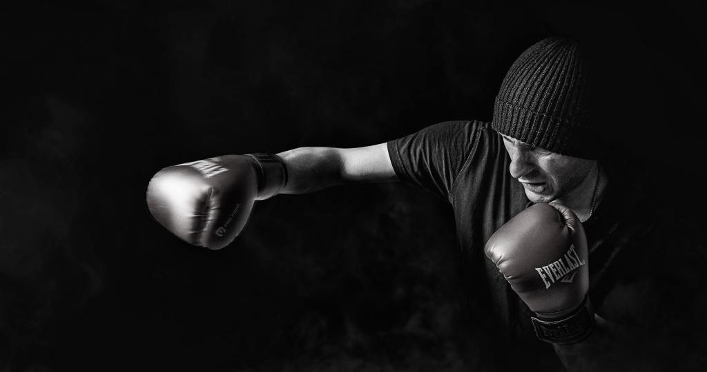This isa picture of a man with boxing gloves punching the air to represent spiritual warfare.