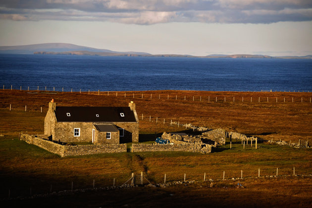 FOULA, SCOTLAND - OCTOBER 02: A view of a property on the Island of Foula on October 2, 2016 in Foula, Scotland. Foula is the remotest inhabited island in Great Britain with a current population of thirty people and has been owned since the turn of the 20th century by the Holbourn family. (Photo by Jeff J Mitchell/Getty Images)