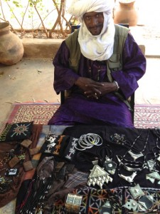 Bang showing the jewelry at my house, which he sells to help the school at Foudouk.