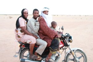 Typically African transport; Zeinaba, Assadek (teachers) Moussa and one of the kids head home.