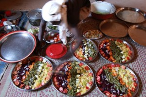 Bahari prepares salads to accompany the stew for the dignitaries who will eat in our residence.