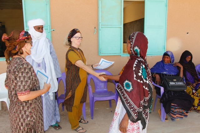 After each matrone demonstrated her understanding of the training, particularly the use of the medicine, Dr. Becky gave them certificates of successful participation in the training.