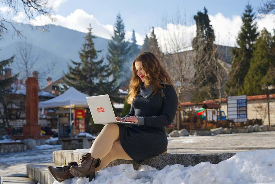 Digital nomad working in the snow