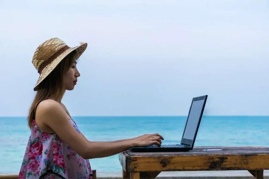 Digital nomad working on beach