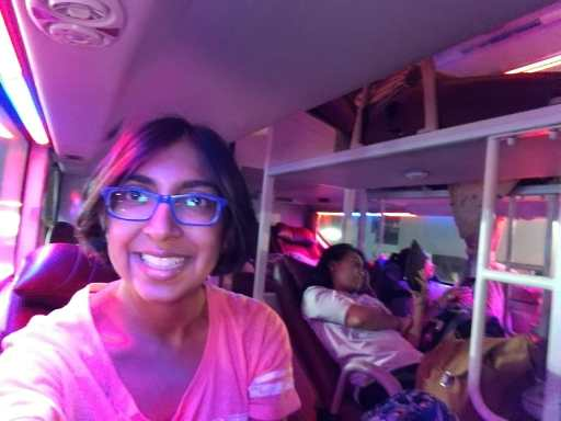 Happy nomad girl on the comfortable sleeper bus from Hanoi to Hue