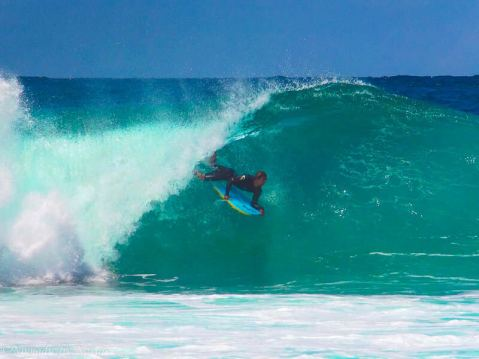 Body-boarder Tucked in at Pipeline, Hawaii
