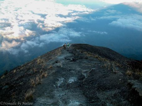 Beginning to descend Mount Agung with its shadow on the clouds in front of us