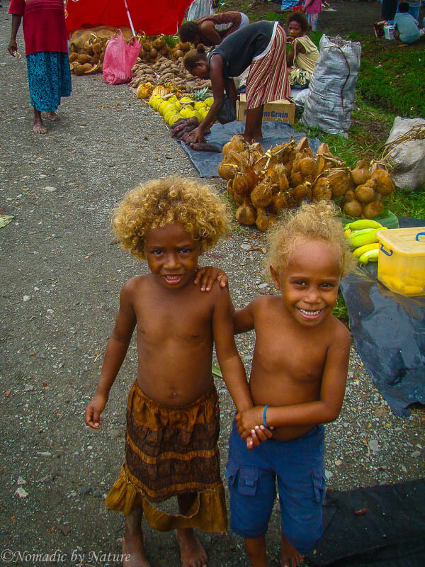 Solomon Island GIrls Playing at the Local Market