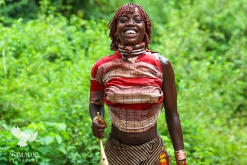 A Hamar Women Jumps with her Horn, Turmi, Ethiopia