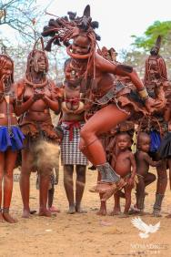 Himba Woman Jumping for Joy at the Ondjongo Dance, Namibia