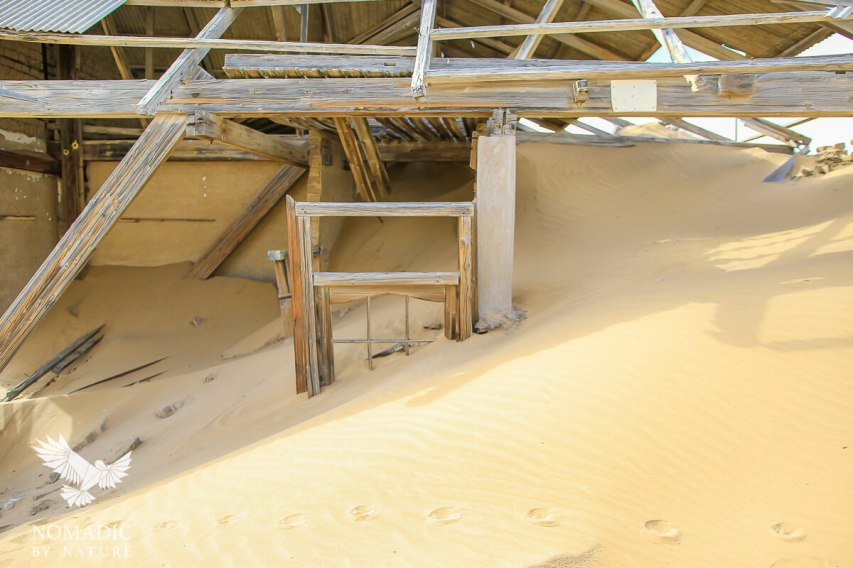 The Exterior of a House Almost Completely Covered by a Dune, Kolmanskop Ghost Town, Namibia