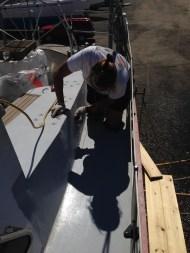 Sanding down the deck.