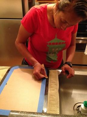Lightly sanding the edges.