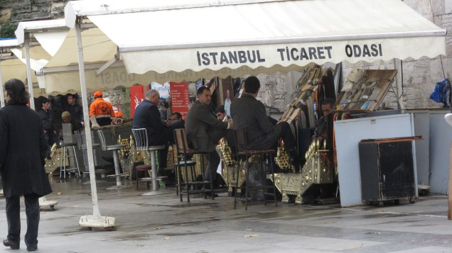 Turkish Businessmen stopping for shoeshine