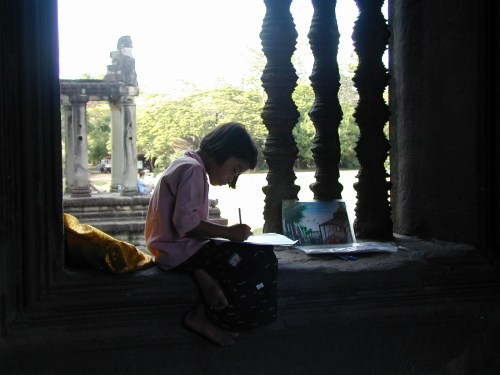 Cambodian Girl Drawing a Picture at Angkor Wat