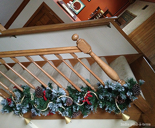 Holiday Decor Twist Garland At The Bottom Of Stair