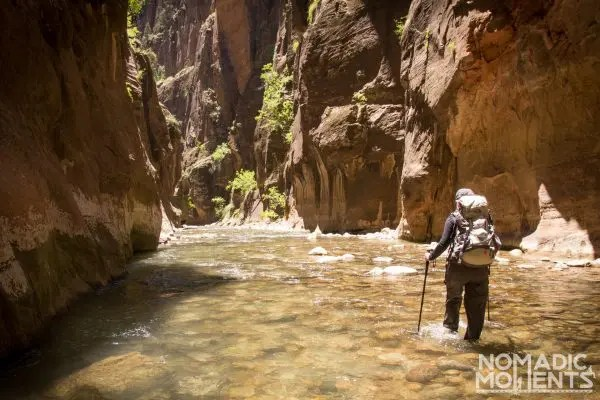 A traveler hiking The Narrows