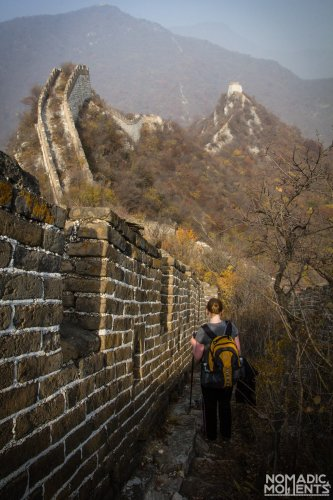 A hiker walks along a section of the Unrestored Section of The Great Wall