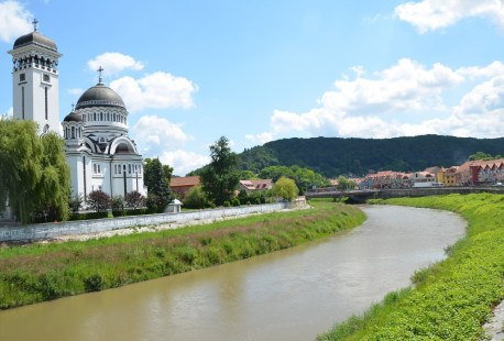Holy Trinity Church and Târnava Mare River in Sighişoara, Romania