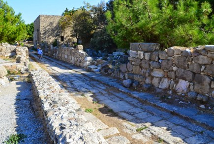 Road with the Nymphaeum at the top left corner in the Western Excavation Area in Kos, Greece