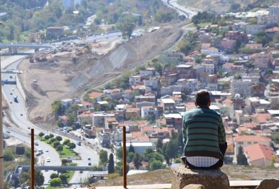 A local enjoying the views at Kadifekale in Izmir, Turkey