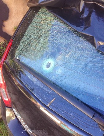 Bullethole in a guest's rental car in Ilhabela, Brazil