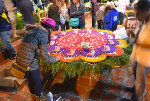 A woman making a float at the Tour de los Silleteros in the Feria de las Flores, Medellín, Antioquia, Colombia