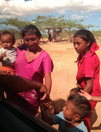 Giving candy and coins to the Wayúu in La Guajira, Colombia