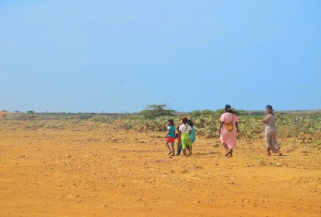 Wayúu people walking to the next village at Punta Gallinas, La Guajira, Colombia